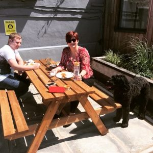 Brack Tours coworkers sunning & picnic lunching at our Abbey Yard Studios location